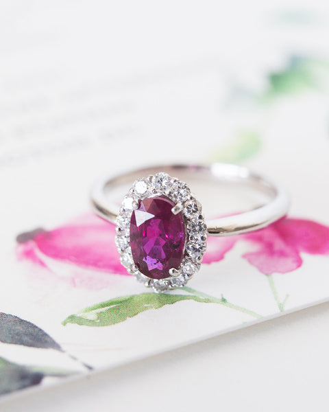 A Beautiful Modern Platinum, Ruby and Diamond Halo Engagement Ring