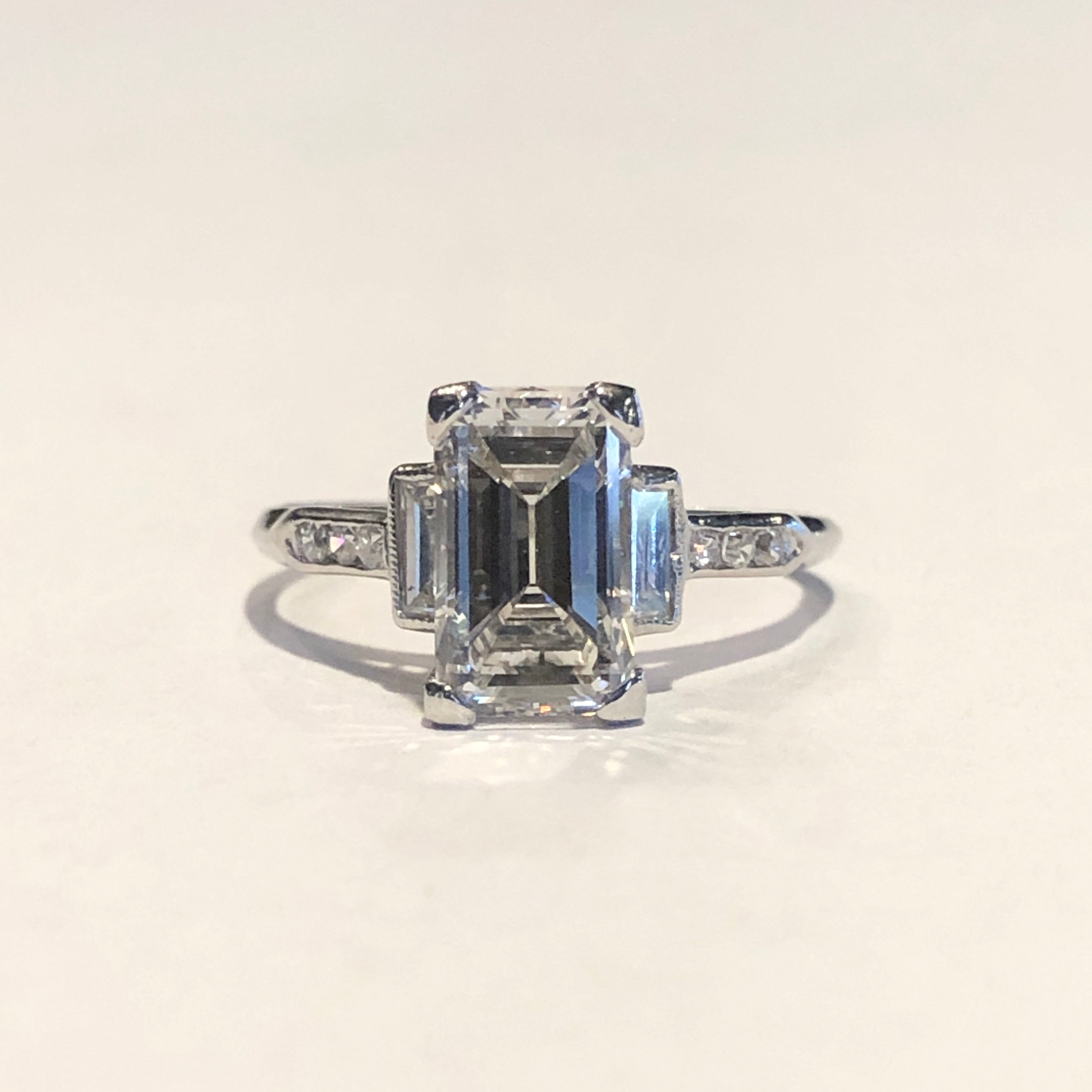 Custom 10014439 Art Deco era ring featuring 1.64ct emerald cut diamond