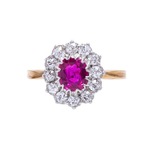 A magnificent Authentic Victorian Era Burma No Heat Ruby and Diamond Halo Ring
