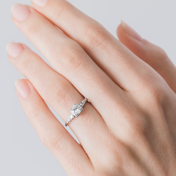 Maybrook an authentic Art Deco era platinum and diamond ring on a hand.