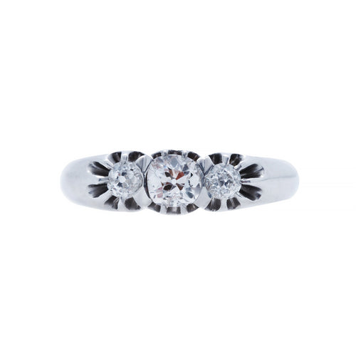 A Charming and Authentic Art Deco Platinum and Diamond Three Stone Ring
