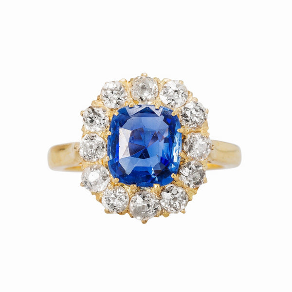 Authentic Victorian Era 18k yellow gold Ceylon Sapphire with diamond halo.
