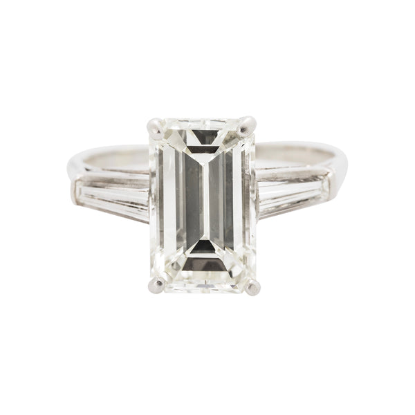 Modern Era Emerald Cut Engagement Ring