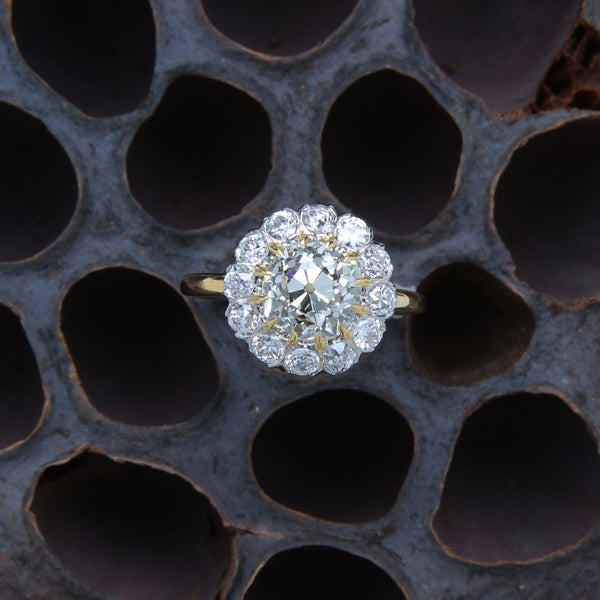 A Beautiful Platinum, 18K Yellow Gold and Diamond Halo Engagement Ring | Abbeybridge