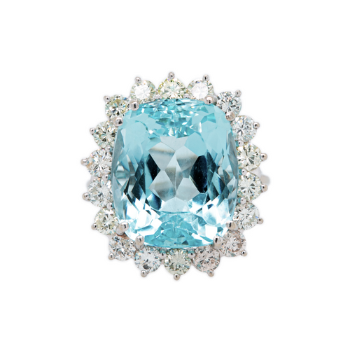 Cape Cod Bay is a stunning 1960s 14k white gold cocktail ring featuring a 15ct aquamarine gemstone surround by a halo of 1.80cts of accent diamonds