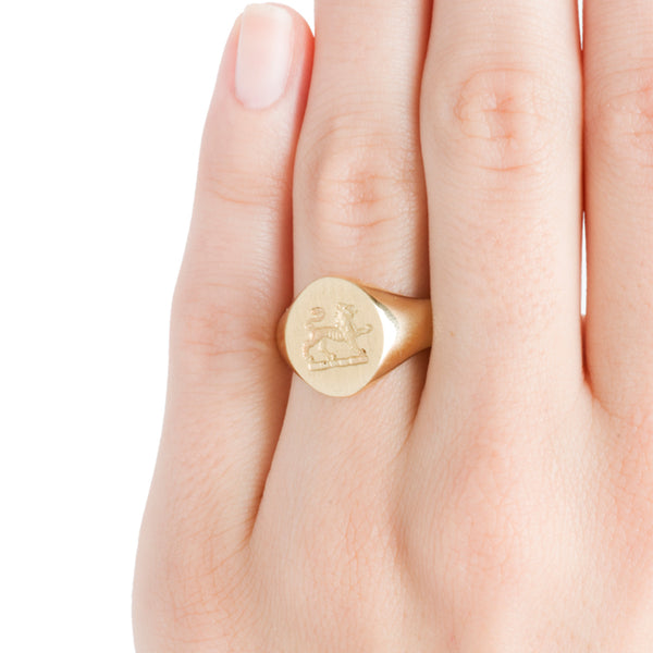 yellow gold crest lion ring on hand