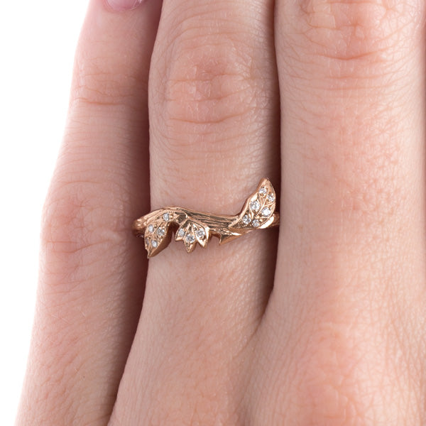 devotion rose gold ring on finger