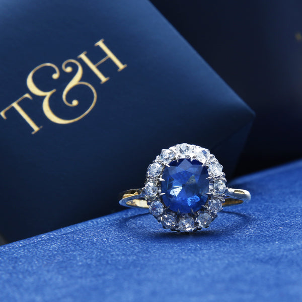 Kamari is a lovely Victorian era antique sapphire and diamond vintage engagement ring set in 18k yellow gold and platinum