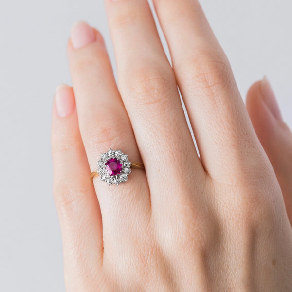 A magnificent Authentic Victorian Era Burma No Heat Ruby and Diamond Halo Ring on hand