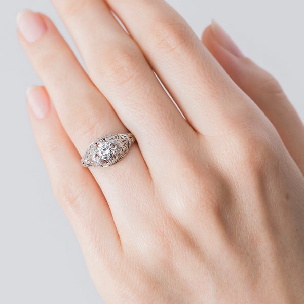 Authentic Edwardian Era Platinum and Diamond Engagement Ring on a hand.