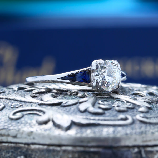 A Striking Art Deco Platinum, Diamond and Sapphire Engagement Ring