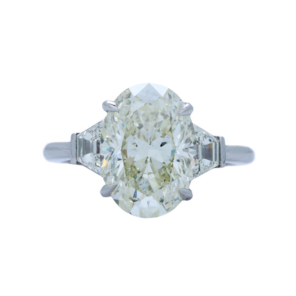 A Showstopping Platinum and Oval Cut diamond Three Stone Ring | Raymond HIll