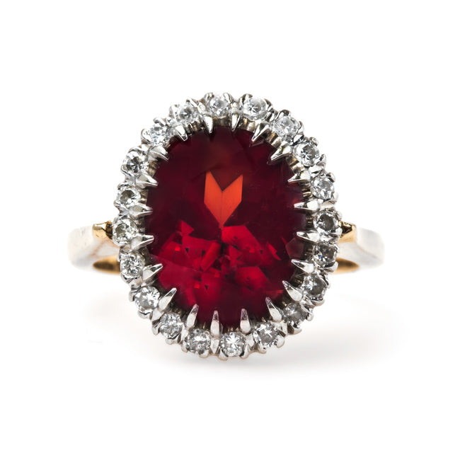 Retro Era Cocktail Ring with Oval Garnet and Diamond Halo | Peppertree Lane from Trumpet & Horn