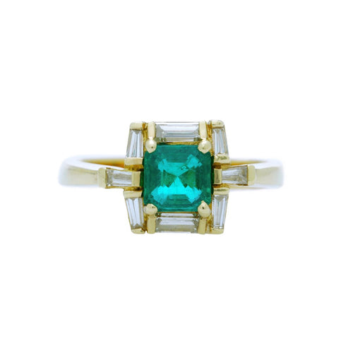 A Dramatic Emerald and Baguette Cut diamond Engagement Ring from the 1980's
