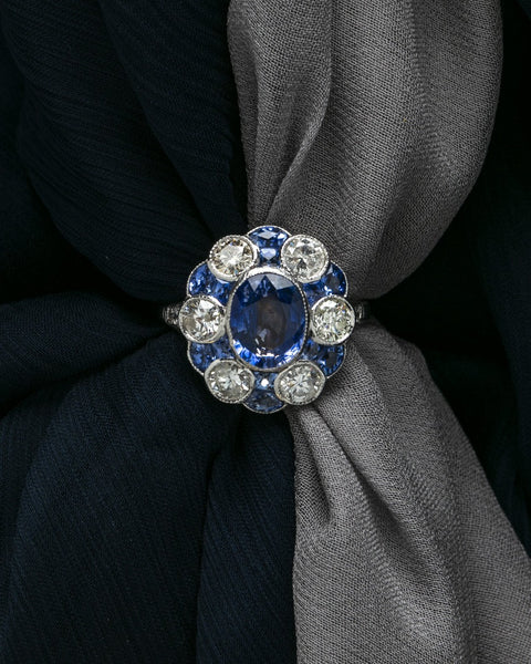 Westmead | A stunning Edwardian Inspired platinum, blue sapphire and diamond cluster ring by Trumpet & Horn