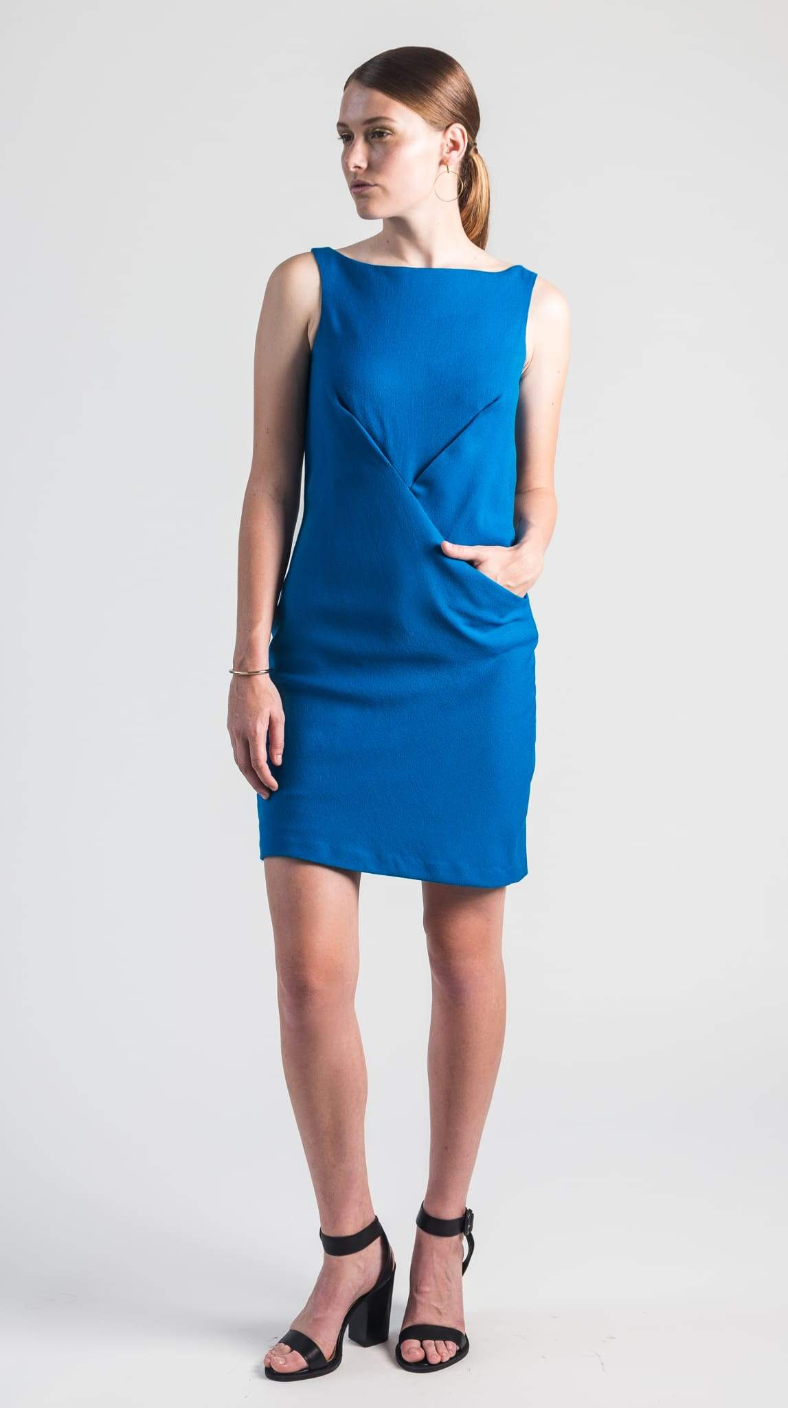Cerulean blue bias-cut wool crepe sleeveless shift dress hidden pocket front pleats lined in silk by Chicago fashion designer Masha Titievsky of VARYFORM.