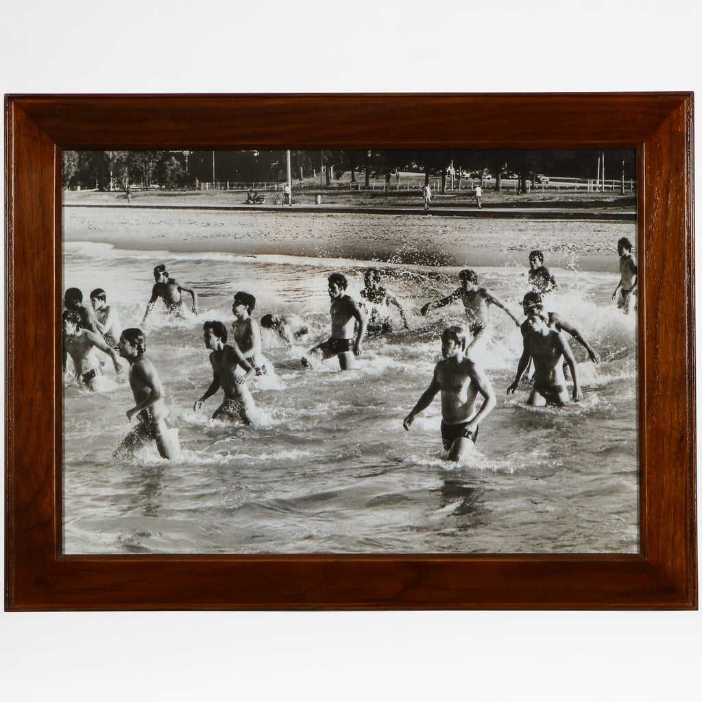 Wading military men print in a walnut frame