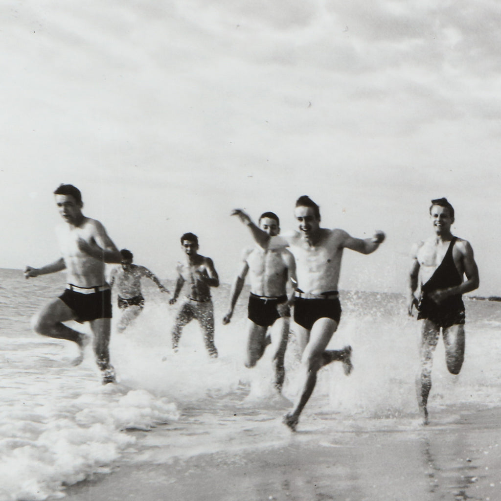 Lifeguards running on the beach