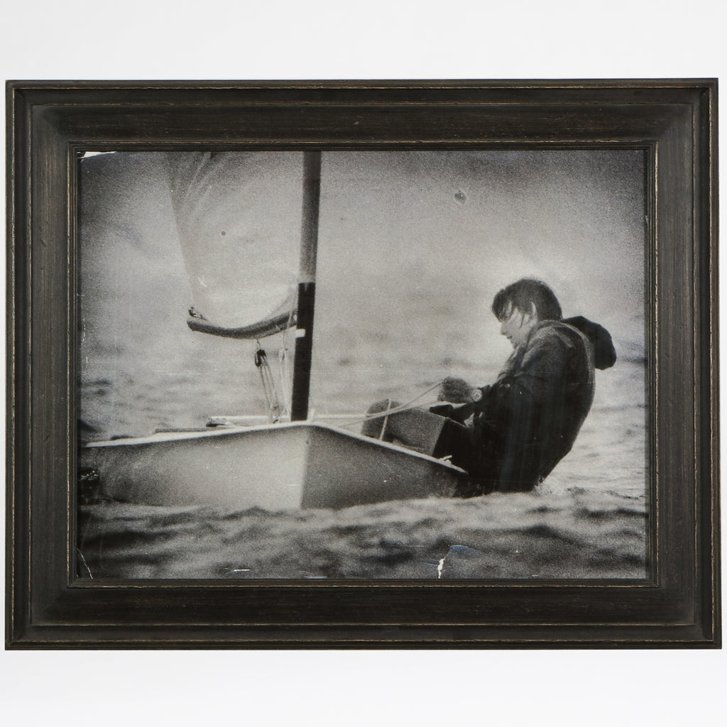 Print of a sailor balancing his sailboat