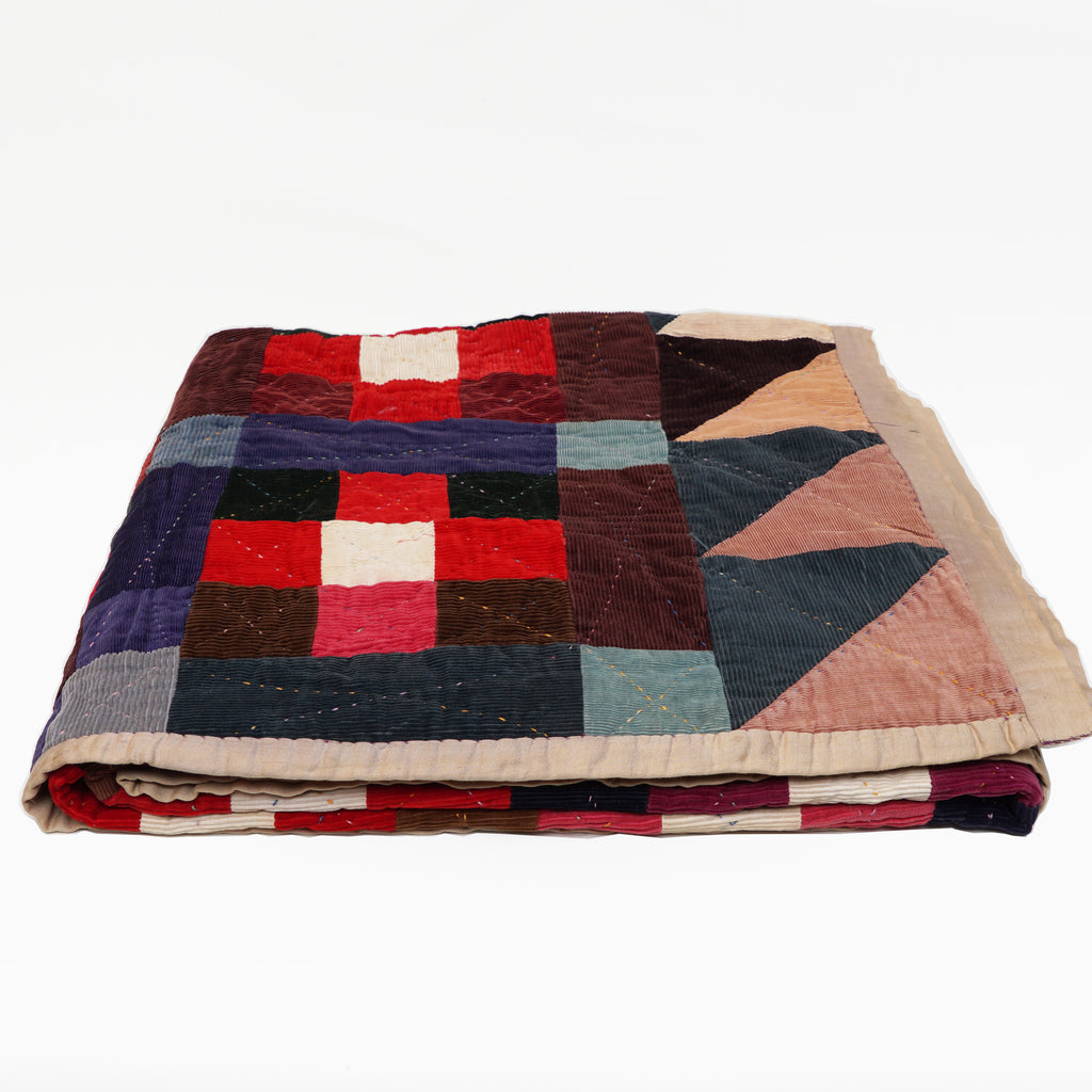 Vintage corduroy patchwork quilt with silk binding circa 1940