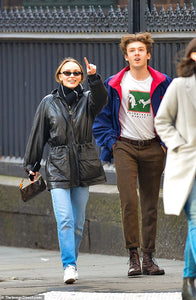Lily-Rose Depp bundles up in leather jacket and a scarf for NYC stroll with male companion