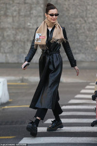 Bella Hadid channels The Matrix as she steps out in flowing leather trench coat and futuristic shades in Milan