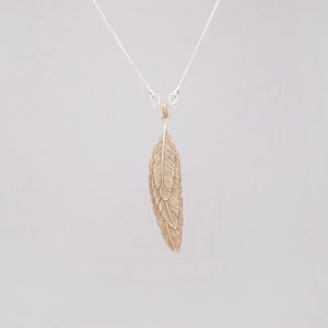FEATHER OVERLAY PENDANT IN YELLOW BRASS