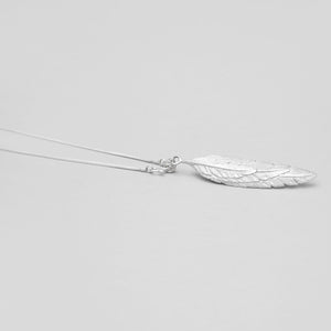WHITE BRASS FEATHER OVERLAY PENDANT