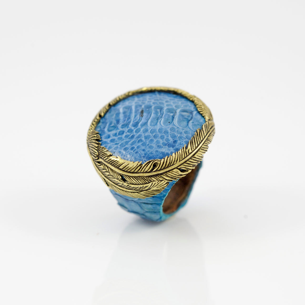 OSTRICH SKIN RING IN TURQUOISE WITH YELLOW BRASS FEATHER CROWN