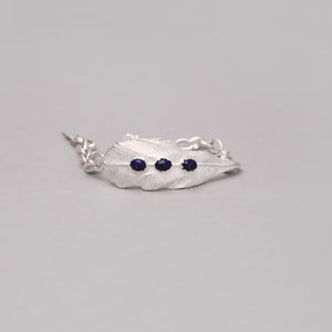 SILVER PLATED FEATHER CHAIN LINK BRACELET WITH LAPIS ACCENT