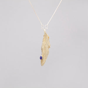 YELLOW BRASS FEATHER PENDANT WITH LAPIS DROP
