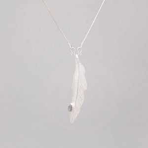 WHITE BRASS FEATHER PENDANT WITH LABRADORITE DROP