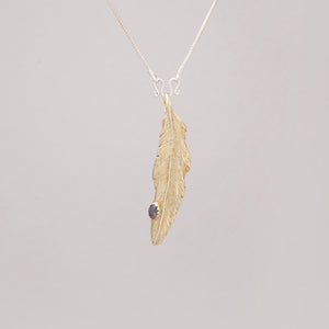 YELLOW BRASS FEATHER PENDANT WITH LABRADORITE DROP
