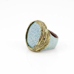 SNAKE SKIN RING IN SKY WITH YELLOW BRASS FEATHER CROWN