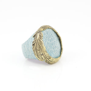 OXOTIC SKIN RING IN SKY WITH YELLOW BRASS FEATHER CROWN