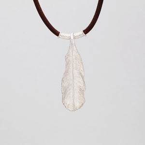 STERLING SILVER FEATHER PENDANT ON LEATHER CORD WITH RUBY EYED EAGLE LOCK