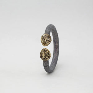 EXOTIC CUFF WITH YELLOW BRASS FEATHER CAPS
