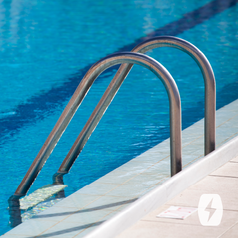 A ladder extends down into a pool
