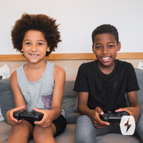 Two kids using video game controllers