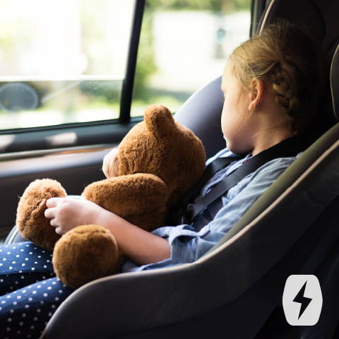 A child sleeps in a car seat