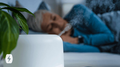 Woman lying down next to a humidifier
