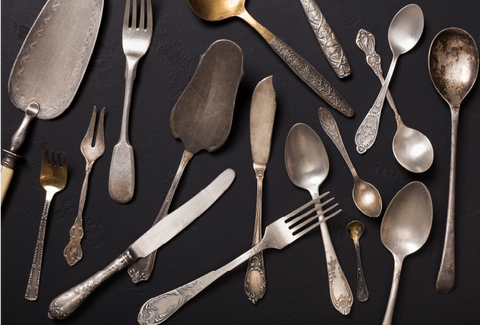 An array of tarnished utensils