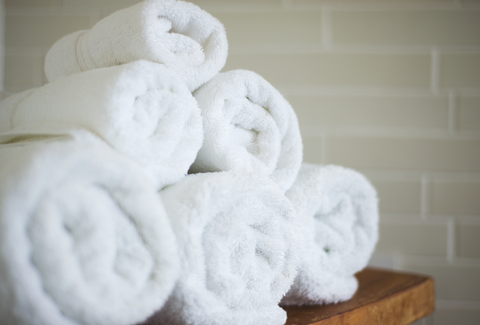 A stack of rolled up bath towels
