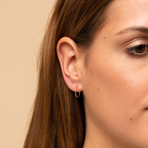 Woman with a gold hoop earring