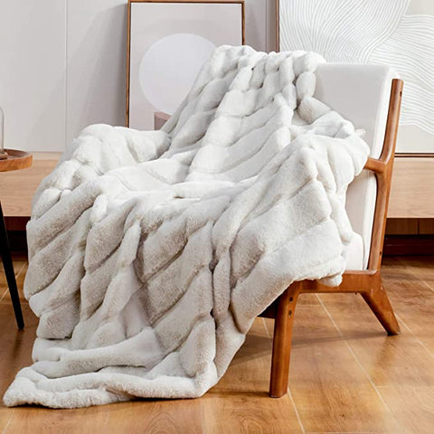 Silver furry blanket draped over chair