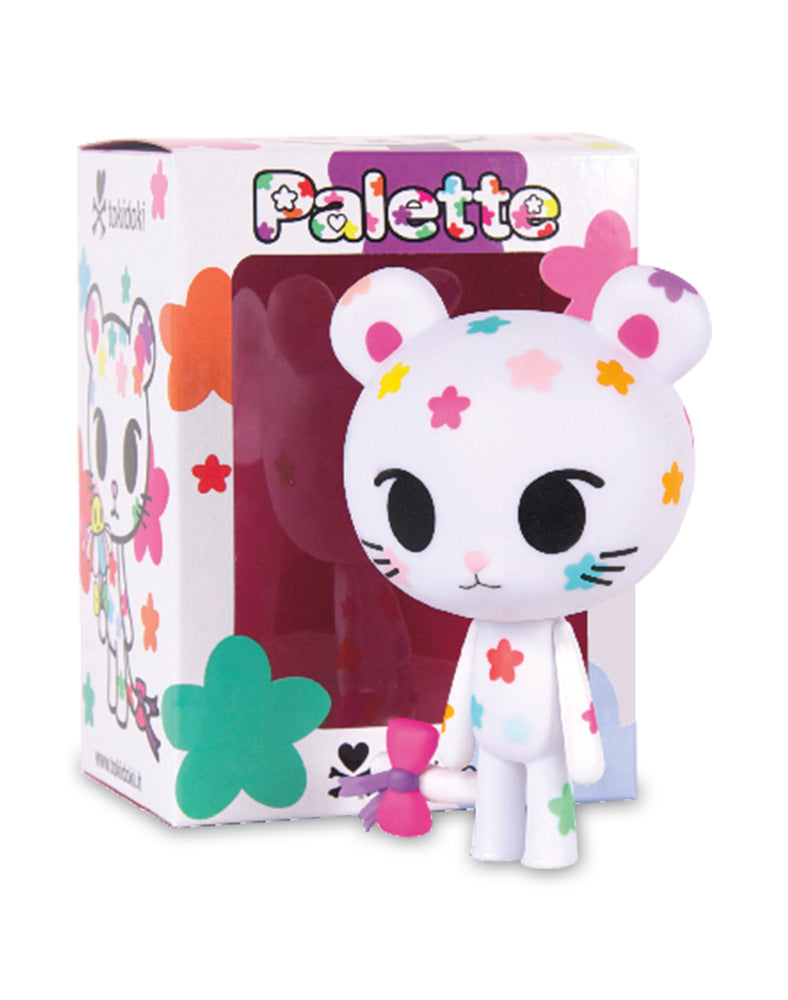 Palette Vinyl figure next to box
