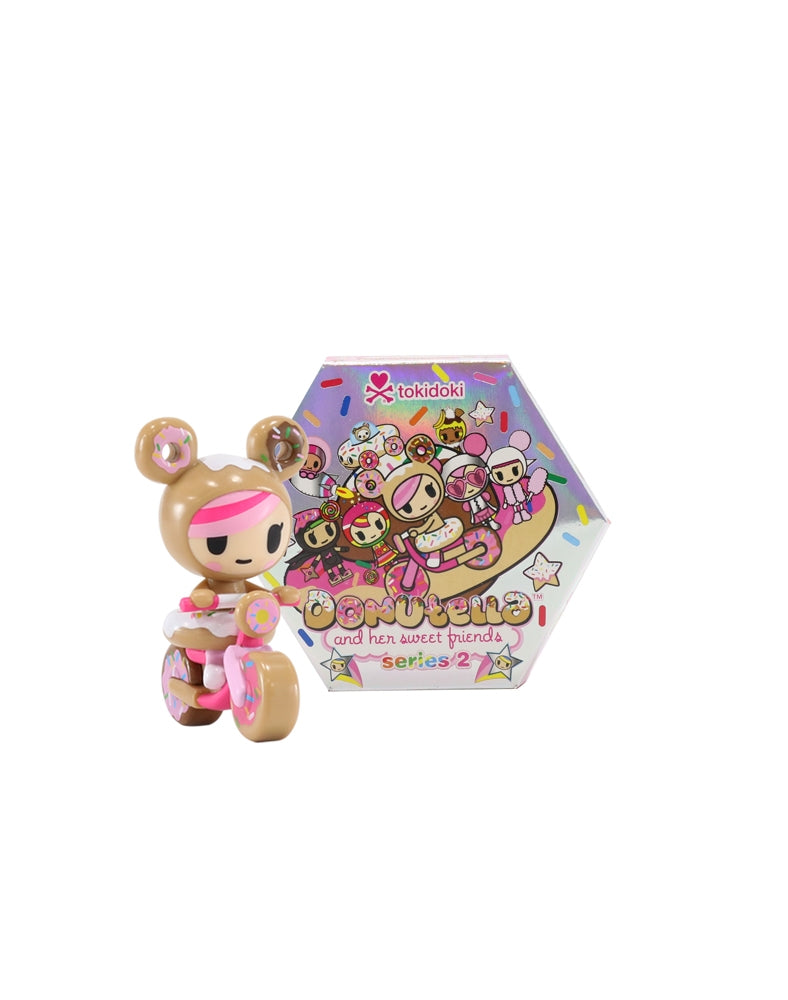 Donutella and her Sweet Friends Blind Box Mini Figures Series 2 figure next to box