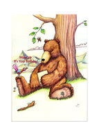 "A birthday card showing a bear asleep under a tree with a brightly coloured bird shouting ""Wake up it's your birthday"""