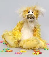 Alfredo Buttercup, a comical yet elegant yellow and white, one of a kind artist teddy bear in stunning hand dyed mohair by Barbara-Ann Bears. Alfredo Buttercup stands 17 inches (43 cm) tall and is 13 inches (33 cm) sitting. He is mostly made from a long and straggly mohair hand-dyed in sunny shades of yellow and gold.