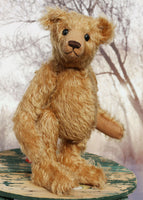 Ambrose is a charming, traditional one of a kind artist bear in German mohair by Barbara Ann Bears, he stands 10 inches/27 cm tall and is 7.5 inches/22 cm sitting. Ambrose is made from beautiful, slightly wavy, warm antique gold German mohair with fawn ultrasuede paw pads and vintage boot buttons for eyes